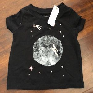 Gymboree black shirt with a moon and star design .